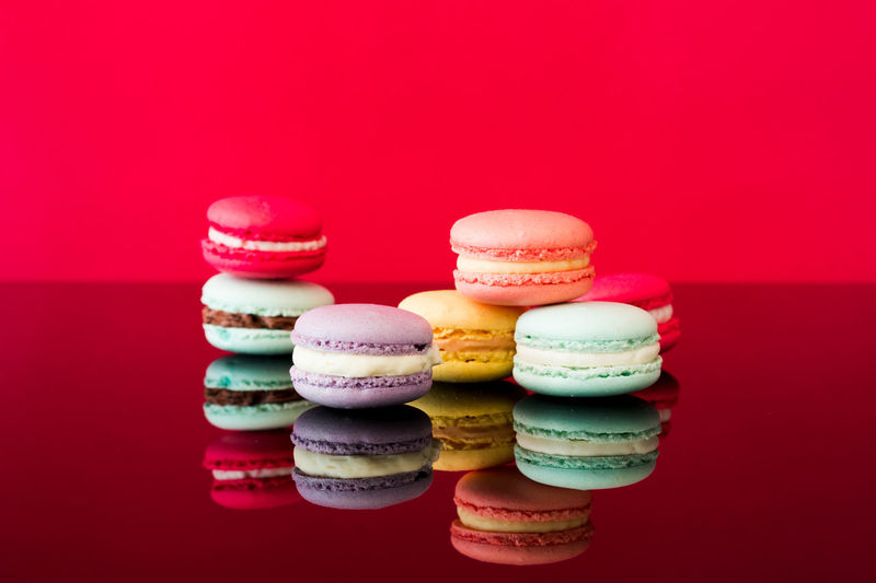 Close-up of multi colored candies against red background