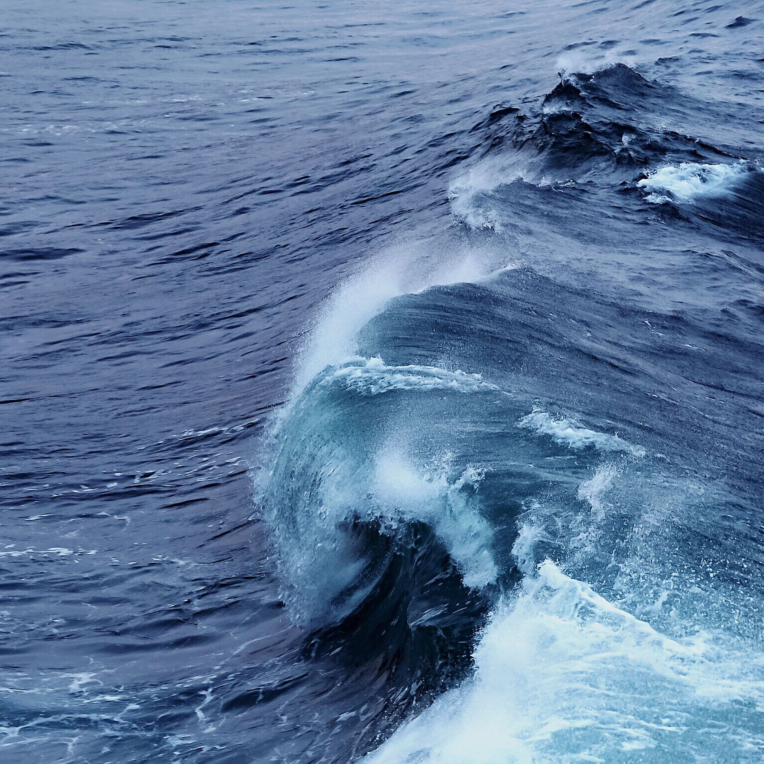 water, sea, wave, motion, waterfront, splashing, rippled, beauty in nature, power in nature, nature, scenics, day, outdoors, no people, tranquility, idyllic, seascape, water surface, tranquil scene, remote, ocean, backgrounds, full frame, close-up, non-urban scene, blue