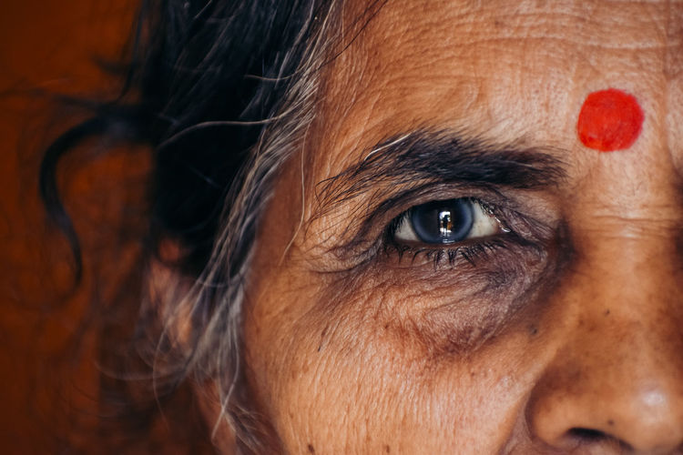 Close-up portrait of old woman eye