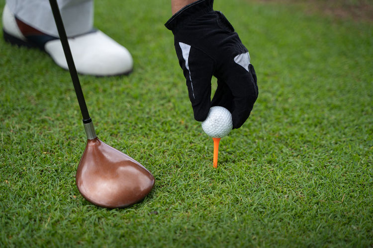 Low section of person playing golf