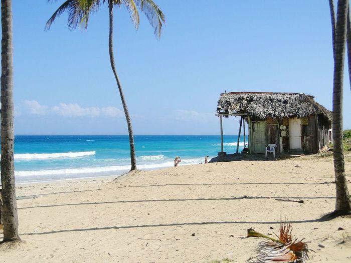Hut At Beach Against Sky