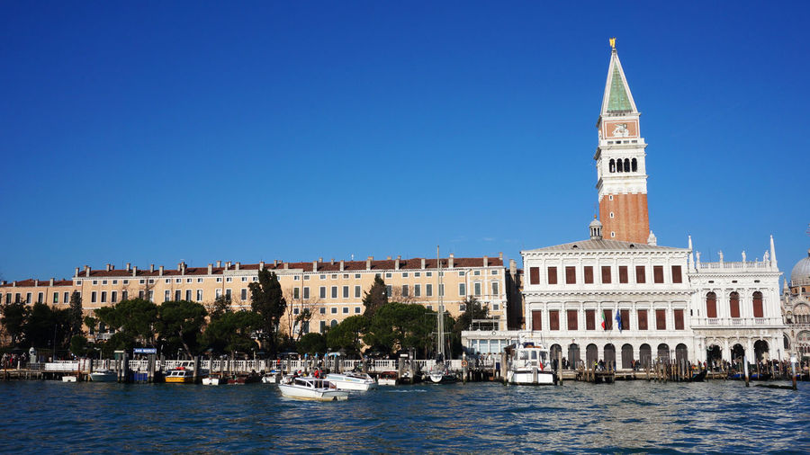 Church of san giorgio maggiore by grand canal against clear blue sky in city