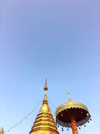 Religion Spirituality Place Of Worship Gold Colored Low Angle View Architecture Built Structure Blue No People Clear Sky Building Exterior Golden Color Outdoors Day Sky