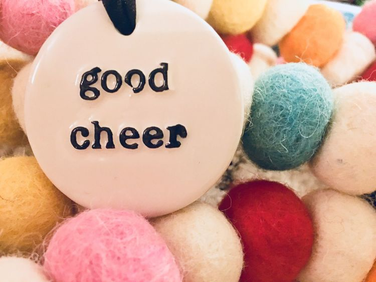 Good Cheer tag with Colorful Garland Round Bright Holidays Christmas Decoration Ball Quote Inspirational Good Cheer Text Close-up Indoors  No People Multi Colored Day