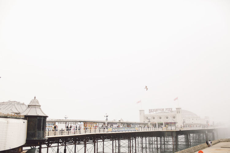 Architecture Beach Brighton Brighton Pier Built Structure City Clear Sky Day Fog Foggy High Section Nature No People Outdoors Pier Sea Shore Sky
