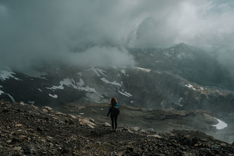Woman standing in fog on mountain