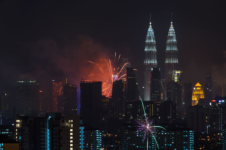 KUALA LUMPUR, MALAYSIA - 1ST JANUARY 2016; New year's eve 2016 celebration over downtown Kuala Lumpur, Malaysia. Architecture Building Exterior Business Finance And Industry City Cityscape Development Downtown District Futuristic Illuminated Modern Night No People Office Building Exterior Outdoors Sky Skyscraper Tower Travel Destinations Urban Skyline