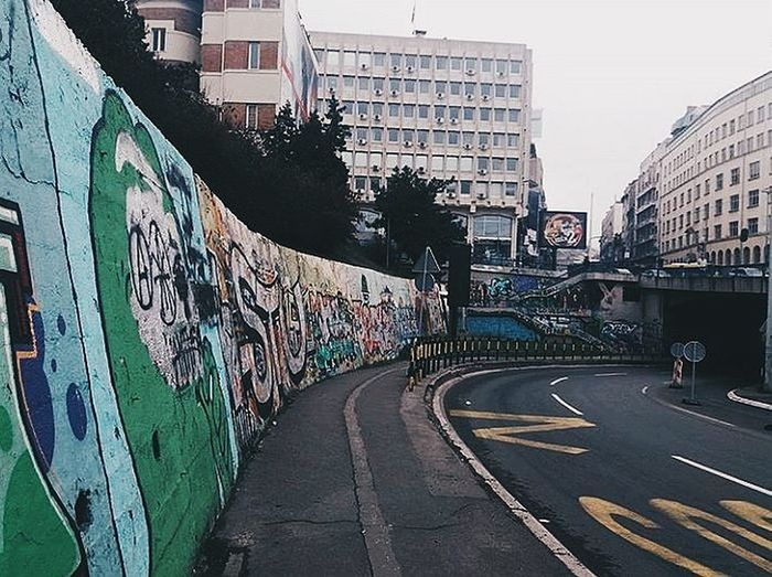 Beograd, Srbija. ❤ Belgrade Belgrade #EyeEmNewHere EyeEmNewHere #beograd #srbija #streetphotography #serbia #photography #picoftheday #urbanphotography #building #buildings City Graffiti Architecture Built Structure Building Exterior City Life Day Outdoors People Sky