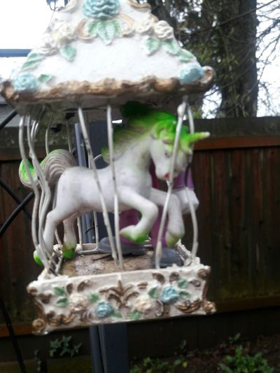 Toy unicorn in a hanging cage Outdoors Close-up Unıcorn