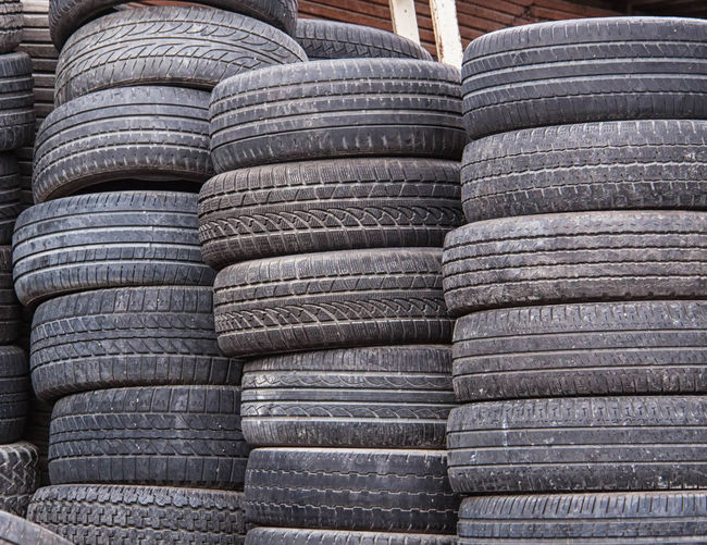 Tires Abundance Arrangement Auto, Automobile, Automotive, Background, Black, Car, Circle, Clean, Close, Closeup, Computer, Design, Equipment, Graphic, Icon, Illustration, Image, Isolated, Modern, New, Nobody, Object, Pattern, Profile, Race, Rain, Rim, Road, Round, Rubber, Service, S Backgrounds Close-up Day Detail Environmental Issues Full Frame In A Row Large Group Of Objects No People Outdoors Recycle Repetition Side By Side Stack Tires Wheels Wood - Material Wooden