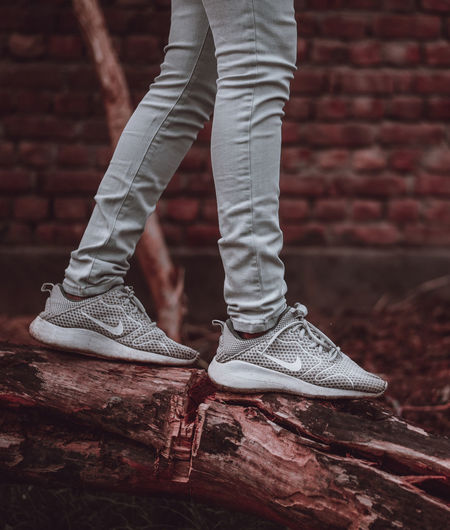 Be adventurous Nike Walking No Face Wallpaper Vertical Composition Body Part Human Leg Human Body Part One Person Shoe Low Section Limb Standing Adult Jeans Casual Clothing Brick Arts Culture And Entertainment Pants Human Foot Textured Effect Close-up Human Limb Brick Wall The Still Life Photographer - 2018 EyeEm Awards The Fashion Photographer - 2018 EyeEm Awards