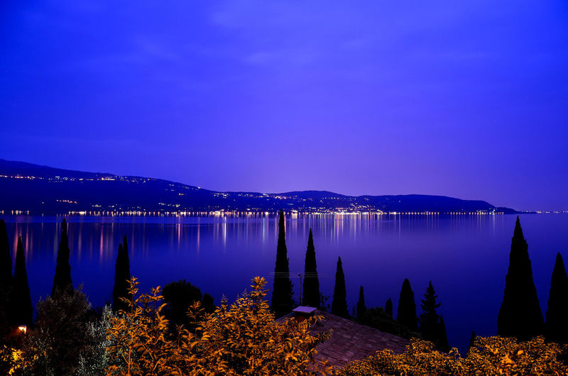 Beauty In Nature Blackandwhite Blue Clear Sky Clouds Evbening Illuminated Italy Italy, Lago Di Garda Lago Di Garda Lake Longexposure Mountain Nature Night No People Outdoors Scenics Sky Tranquil Scene Tranquility Tree Trees Water Lost In The Landscape