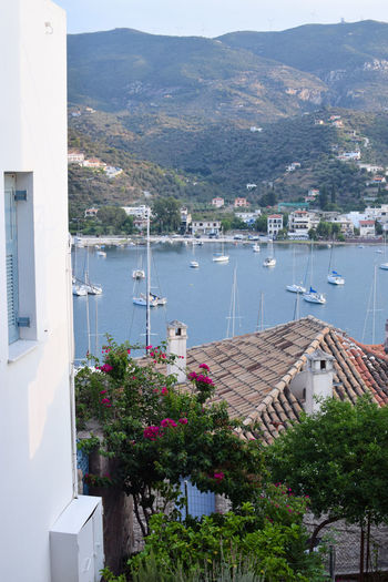 Sailboats under the Greek summer sky Exploring Greek Islands Mediterranean  Travel Architecture Bay Beauty In Nature Day Greece High Angle View Mode Of Transportation Mountain Nature Nautical Vessel No People Outdoors Plant Sailboat Sailing Sea Tourism Transportation Travel Destinations Tree Water