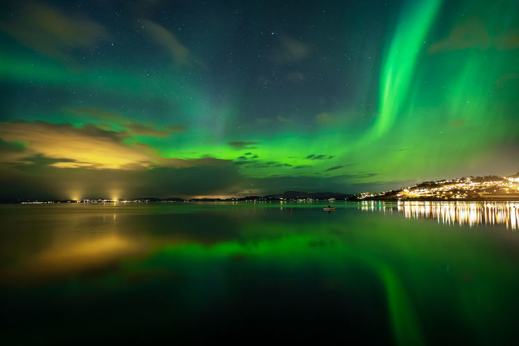 Scenic View Of Lake Against Aurora Borealis At Night