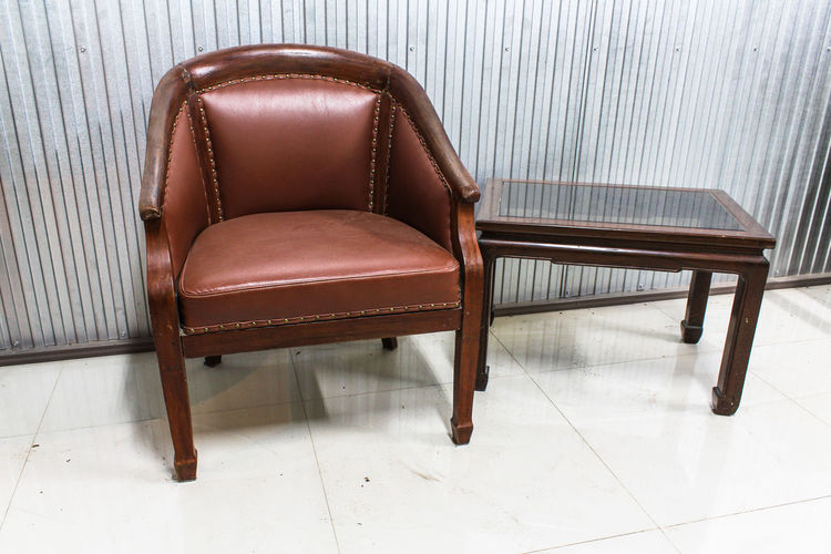 vintage style of interior decoration the leather sofa in room Vintage Style Of Interior Decoration The Leather Sofa In Room Seat Chair Furniture Empty Absence Indoors  Flooring No People Table Wood - Material Armchair Relaxation Tiled Floor