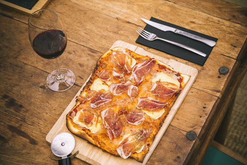 Atmosphere Baked Brie Cooked Cured Cutlery Cutting Board Food And Drink Ham Hanging Out Iberian Food Italian Food Knife Meat Mediterranean Food Pizza Red Wine Restaurant Rustic Serrano Snack Table Traditional Wine Wood - Material