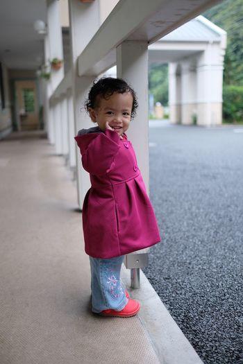 Portrait Of Girl Standing In Corridor