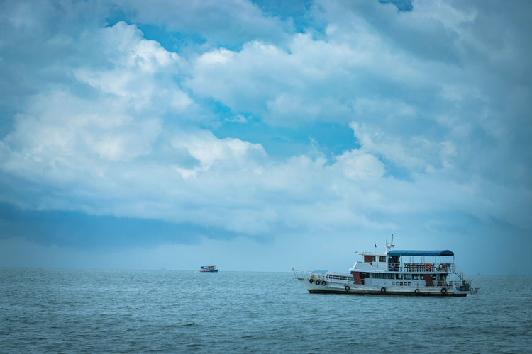 passenger ship in ocean Sea Sky Cloud - Sky Transportation Mode Of Transportation Water Ship Sailing Scenics - Nature Day Nature Beauty In Nature Outdoors Passenger Craft Cruise Ship Fishing Boat Passenger Ship Water Transportation Ocean View Ocean Travel Thailand Journey