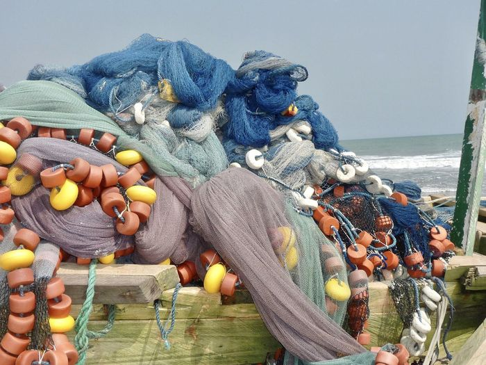 Fishing nets on boat moored at beach