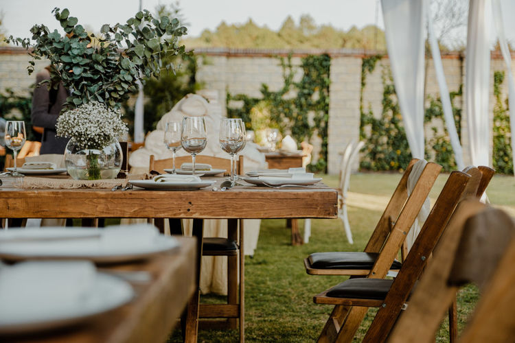Empty chairs and tables at party