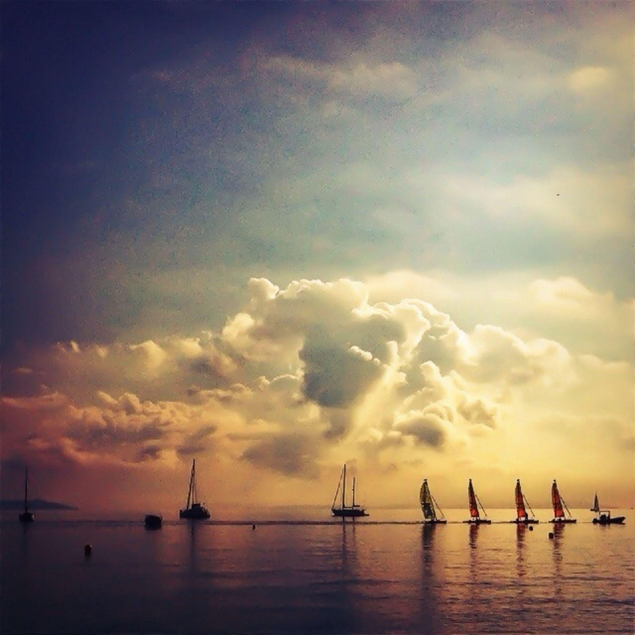 sunset, water, sea, sky, nautical vessel, waterfront, cloud - sky, boat, transportation, orange color, mode of transport, scenics, silhouette, beauty in nature, tranquility, tranquil scene, nature, cloud, sailboat, idyllic