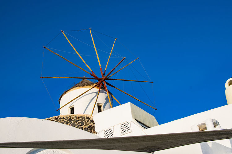 Architecture Blue Building Exterior Built Structure Clear Sky Greece Low Angle View Outdoors Sky Traditional Windmill Windmill EyeEm Best Shots EyeEm Masterclass Exceptional Photographs Day No People