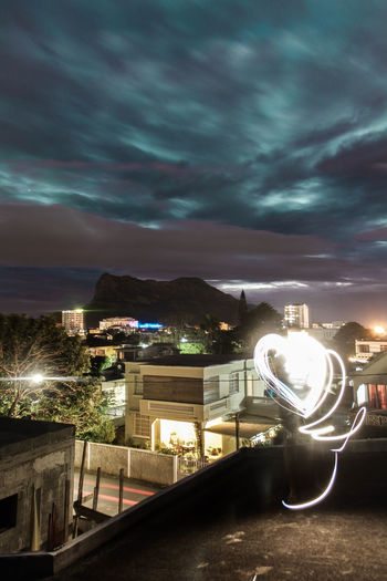 A long exposure on the roof of my house Long Exposure Shot Architecture Building Exterior Built Structure Cloud - Sky Illuminated Light Trail Lightning Long Exposure Mountain Nature Night No People Outdoors Sky Storm Cloud Tree