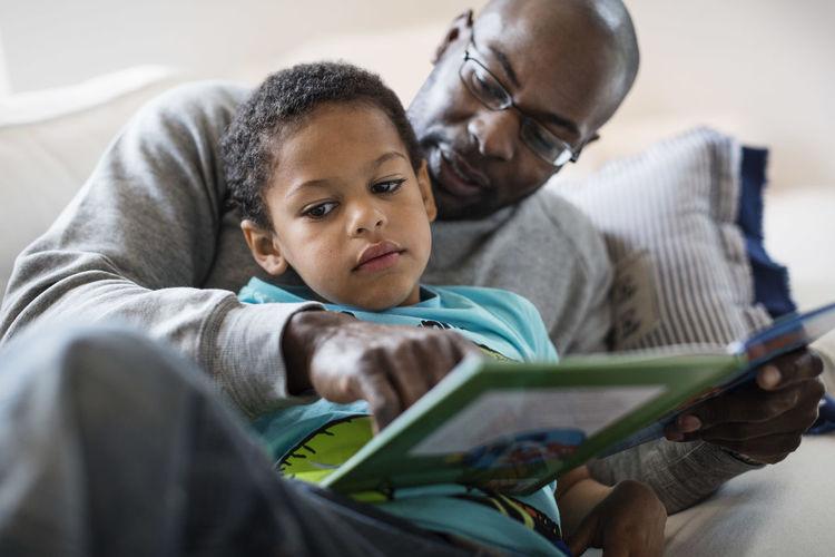 Boy looking at book