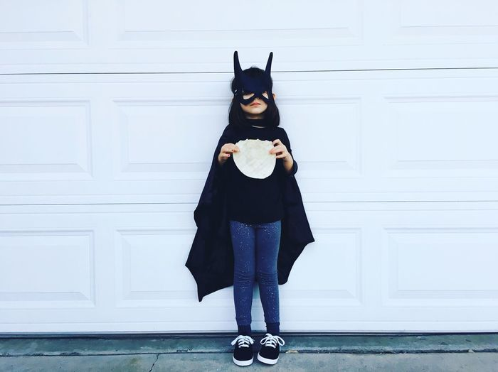 Portrait Of A Girl Wearing Batman Mask