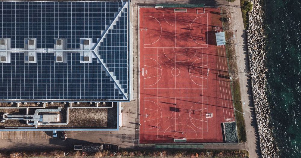 Aerial view of basketball court by building