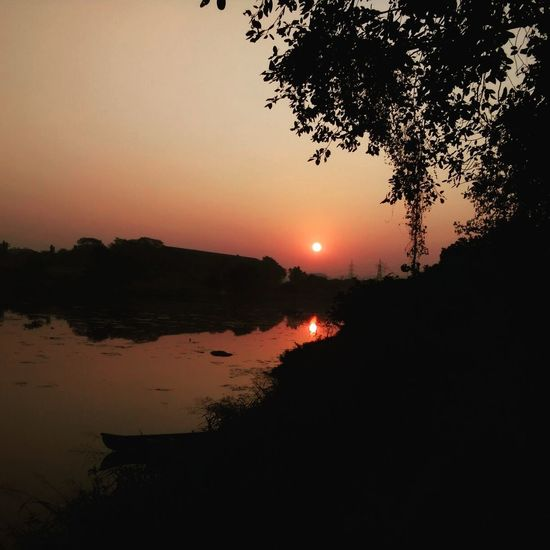 Mumbai in India Sunset Tree Lake Tourism Nature Landscape Reflection Sky Travel Beauty In Nature Water Silhouette Outdoors Vacations Travel Destinations Scenics Natural Parkland No People