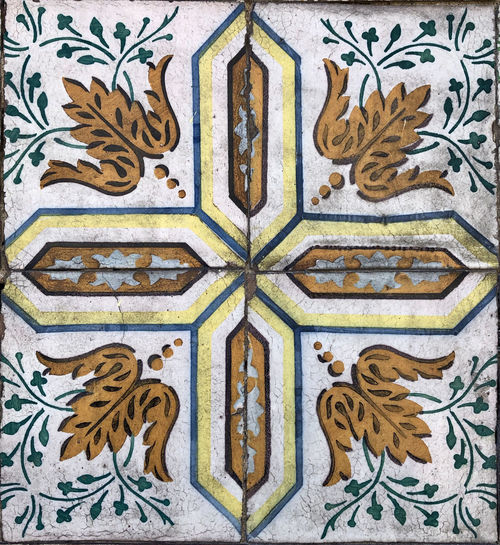 Full frame close up of ceramic tiles wall pattern in Lisbon, Portugal Lisbon Portugal Tile Ceramic Tiled Pattern Art And Craft Full Frame Close-up No People Backgrounds Floral Pattern Creativity Design Architecture Craft The Past History Built Structure Day Religion Multi Colored Flooring Wall - Building Feature Ornate Mural