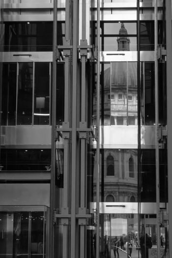 Reflection of building on glass window