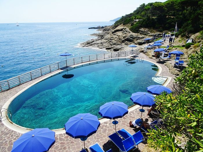 Water Sea Nature Beauty In Nature Scenics - Nature Tranquility Swimming Pool Day Tranquil Scene Land Blue Beach Pool Travel Destinations Tourist Resort Idyllic High Angle View Sky Outdoors Horizon Over Water Relaxing