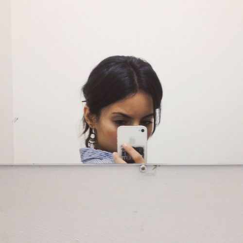 Mirror Reflection Of Young Woman Taking Selfie With Mobile Phone