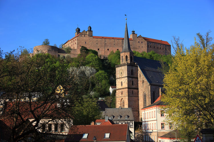 old city and castle Plassenburg and church Petrikirche of Kulmbach, Frankonia, Bavaria, Germany Plassenburg Architecture Belief Blue Building Building Exterior Built Structure Clear Sky Day Fort History Kulmbach Low Angle View Nature No People Outdoors Place Of Worship Plant Religion Sky The Past Travel Destinations Tree