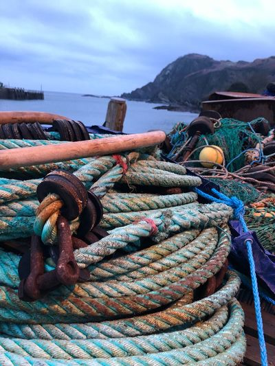 Harbour activity Transportation Nature Fishing Tied Up Beach Metal Nautical Vessel Fishing Industry Outdoors Security Cloud - Sky Tangled