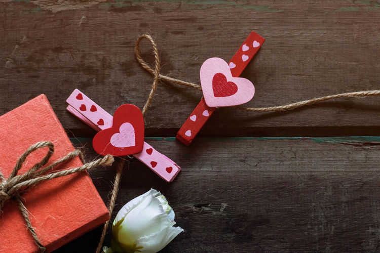 High angle view of heart shape clothespins