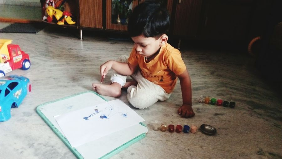 EyeEm Selects Child Artist Indoors  Looking Down High Angle View Concentration Learning Skill  Day Real People