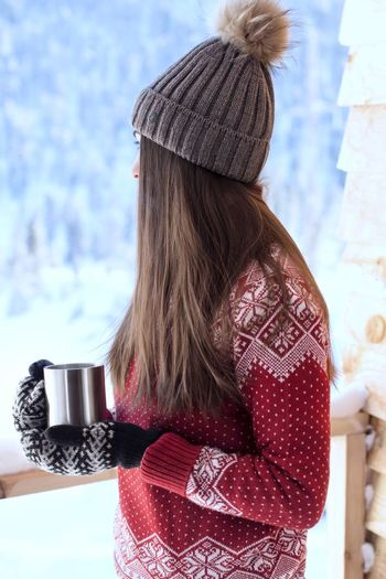Young woman in red sweater with hot drink in winter Hot Coffee Mug Snowy Warming Morning In The Mountains Winter Sweaterweather Sweater Hot Drink Mittens Cozy Hot Tea Village View Day Nature Women Drink Holding Lifestyles Refreshment Clothing Outdoors Sunlight