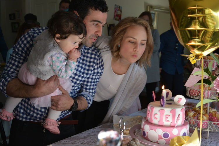 1st Birthday 1st Birthday Atmospheric Mood Birthday Birthday Cake Birthday Candles Bithday Party Candle Celebration Child Domestic Life Family Family Flame Indoors  Kids Being Kids Kids Party Oelebration Parents And Children Party Party - Social Event People Togetherness