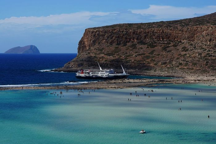 Balos Lagoon Bay Beauty In Nature Blue Boat Crete Day Ferry Lagoon Leisure Activity Mediterranean Sea Mountain Nature Nautical Vessel No People Outdoors Scenics Shallow Water Ship Tourism Travel Travel Destinations Vacations Water