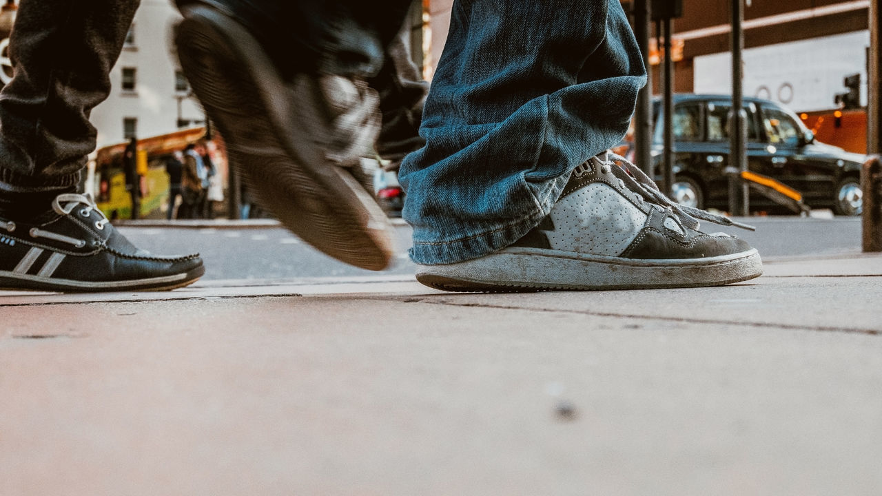 low section, shoe, human leg, human body part, human foot, men, standing, real people, day, two people, sitting, outdoors, close-up, adult, people