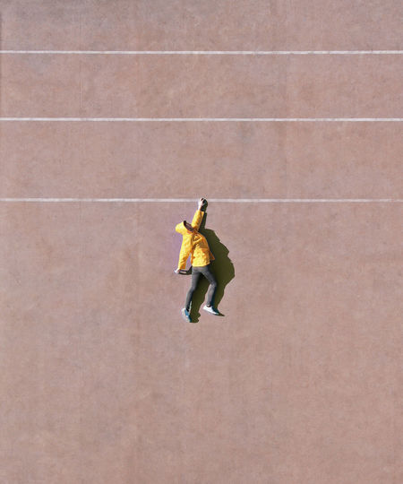 Aerial surrealism high angle view of a man