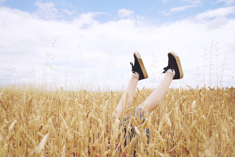 Adult Agriculture Arms Raised Cloud - Sky Crop  Day Environment Farm Field Growth Hairstyle Human Arm Land Landscape Lifestyles Nature One Person Outdoors Plant Real People Rural Scene Sky Women Young Adult