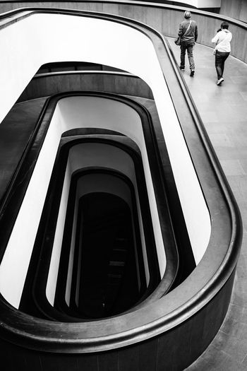 Architecture Couple Moving Around Rome Stories From The City Tourist Travel Vatican Architecture Black And White High Angle View Lifestyles Museum Railing Real People Shapes And Forms Staircase Steps Steps And Staircases Travel Destinations vanishing point Vatican Museum