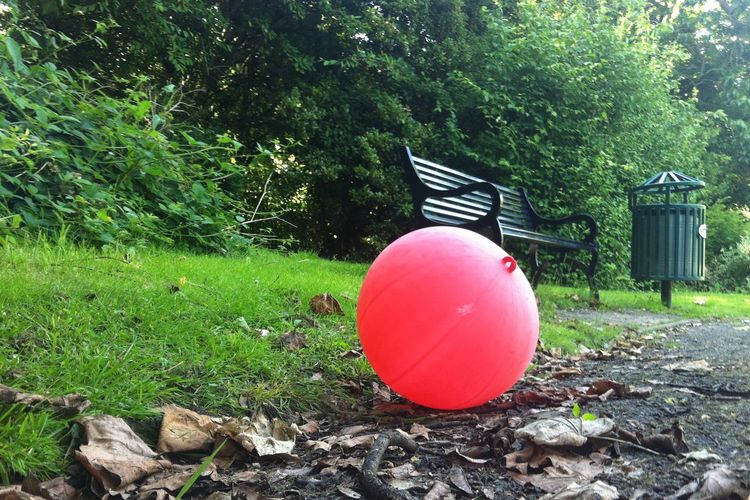 Surreal Eerie Red Balloon Blowup Maryon Park London Park Green Color Grass Tree No People Outdoors Day Pink Color