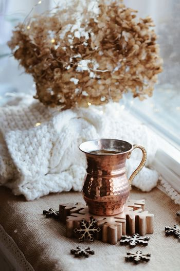 High angle view of jar with snowflake on table