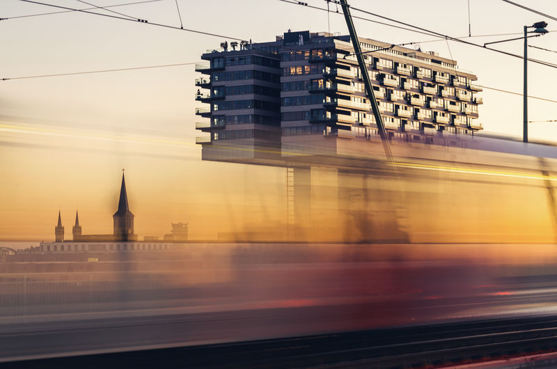 View of the crane house in Cologne germany at sunset Cologne Motion Blur Traffic Tram Traveling Architecture Blurred Motion Building Exterior Built Structure City Clear Sky Cologne Cathedral Crane Houses Mood Motion No People Outdoors Public Transportation Rheinauhafen Skyscraper Speed Sunrise Sunset Transportation Travel Destinations