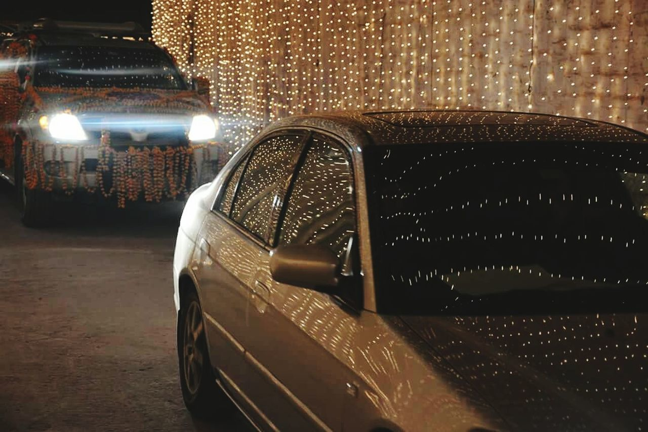 car, night, land vehicle, illuminated, indoors, no people, transportation, close-up, architecture